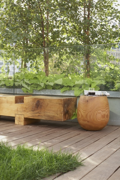 Great bench seat, decking and generous planting.