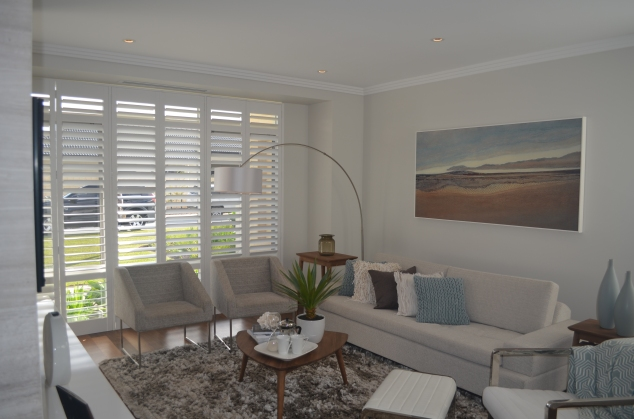 I love the white shutters and wood floors in the Etesian display home.