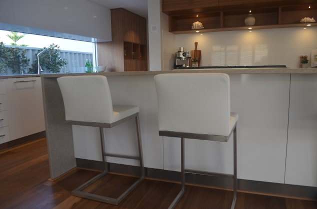 "A ""waterfall"" kitchen bench in the ""Etesian"" kitchen."
