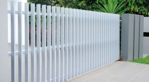 Not wood.  Plain and simple, for showing off the garden.  Photo from: Factory Direct Fencing.