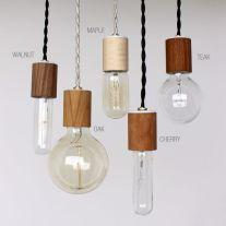 Wood veneered pendant light. USD $45 each.