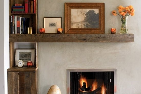 A stainless steel fire surround and a beautiful old beam mantle dress up this fireplace.