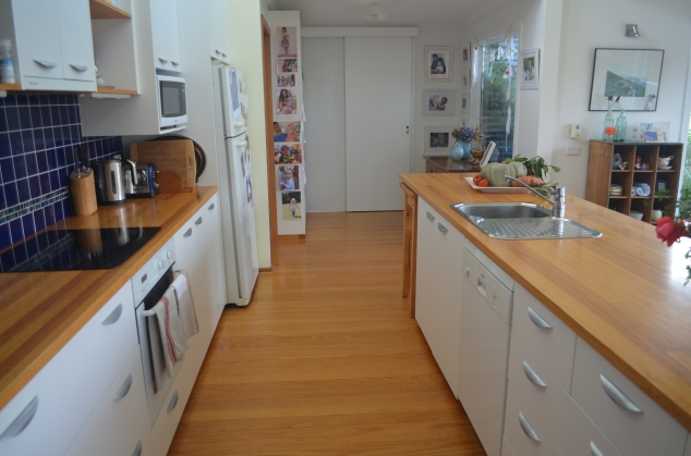 Tasmanian Oak Kitchen Island and Alpine Ash floors salvaged from bush fires.
