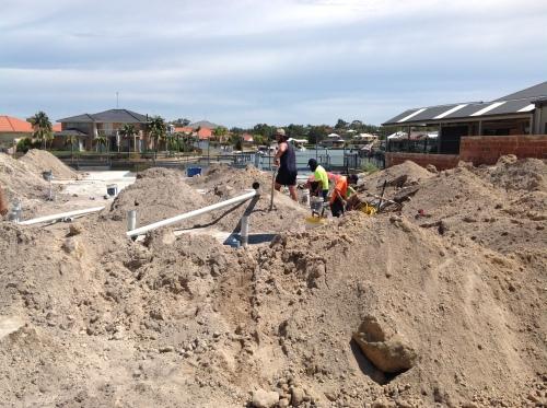 Digging drains.