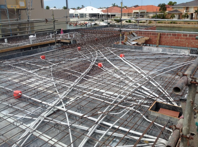 This network of electrical conduits and steel is now hidden in our concrete slab.