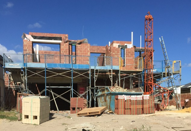 Front facade.  The feature column will be bricked to 80 courses.