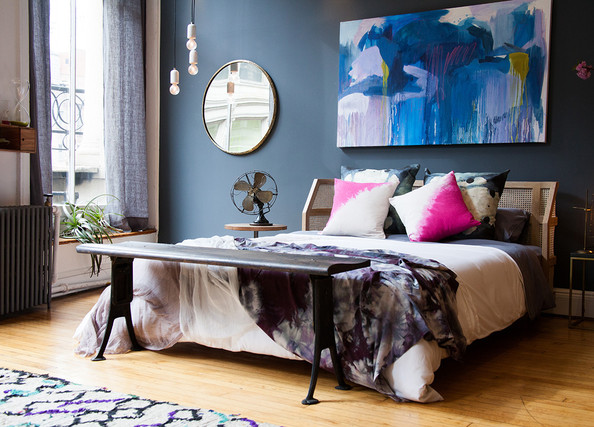 The colour adds mood, without drowning the whole room.  Source:  Lonny.