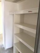 Broom and linen cupboard.