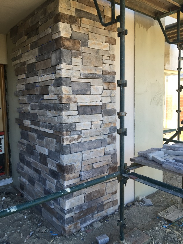 Stacked stone cladding.