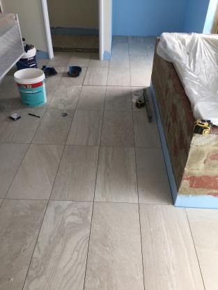 Ensuite tiling.