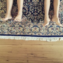Library floor, Persian rug.